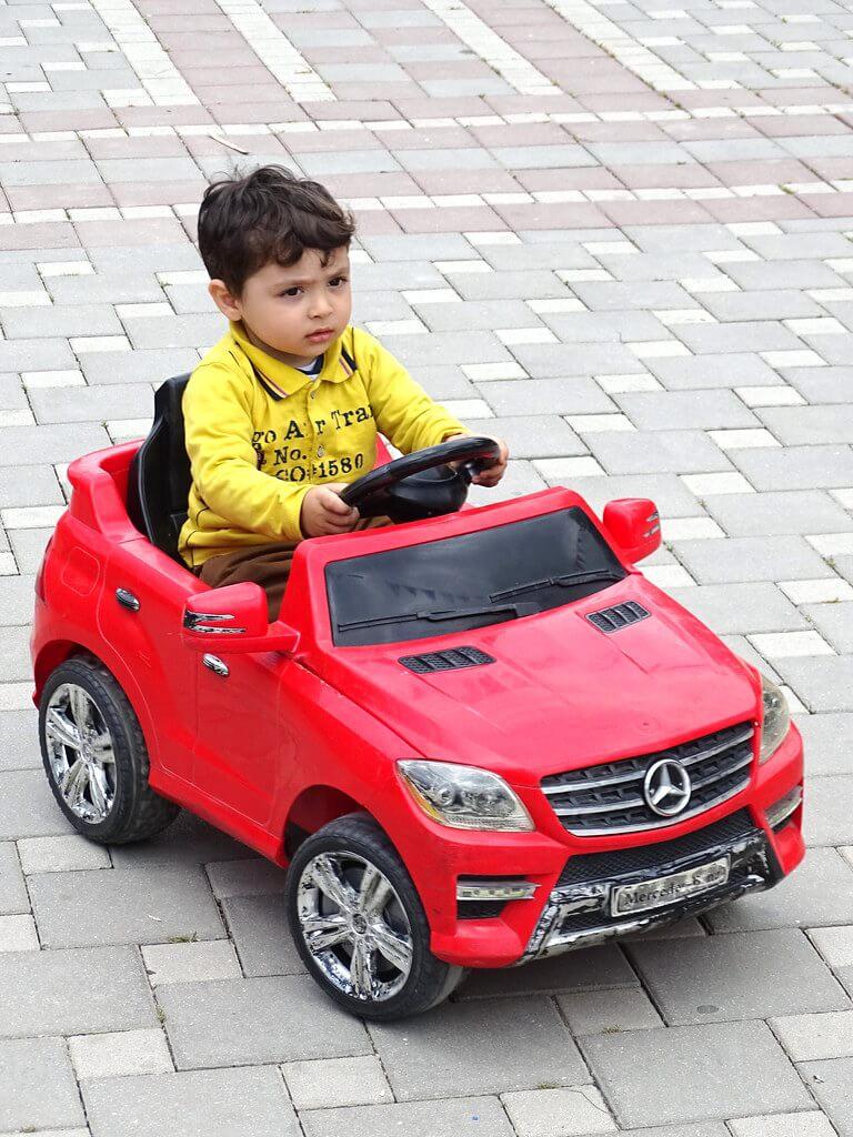 kid riding toy car
